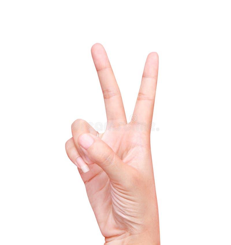 Mano destra asiatica della donna e fare gesturing del segno di vittoria o il segno di pace con due dita isolate su fondo bianco c immagini stock