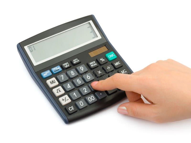 Mano e calcolatore di affari fotografia stock