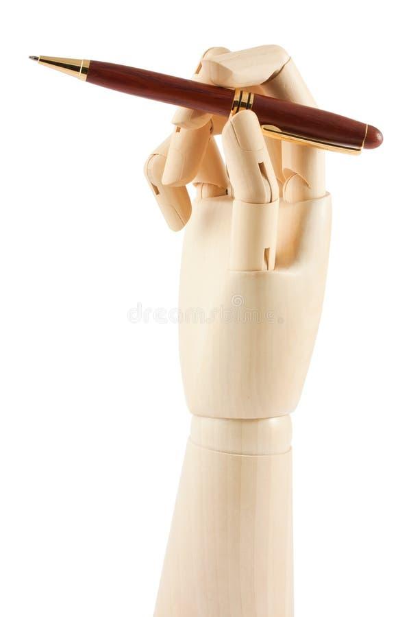 Mano e penna di legno fotografie stock