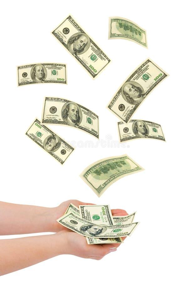 Mano e soldi di caduta immagine stock libera da diritti