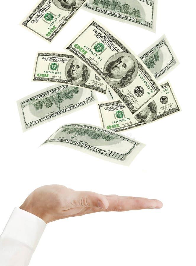 Mano e soldi di caduta isolati su bianco immagini stock