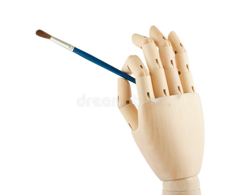 Mano e spazzola di legno immagini stock libere da diritti