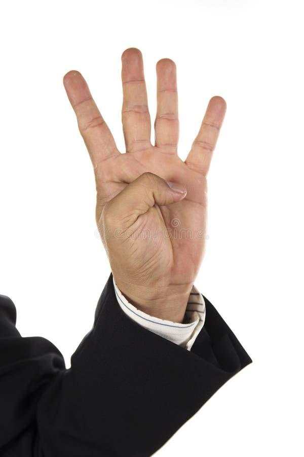 Mano ed uomo d'affari che mostrano quattro dita fotografie stock