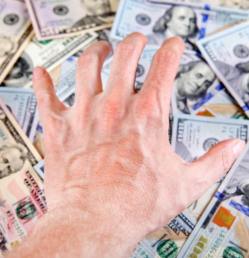 Mano en el dinero fotografía de archivo