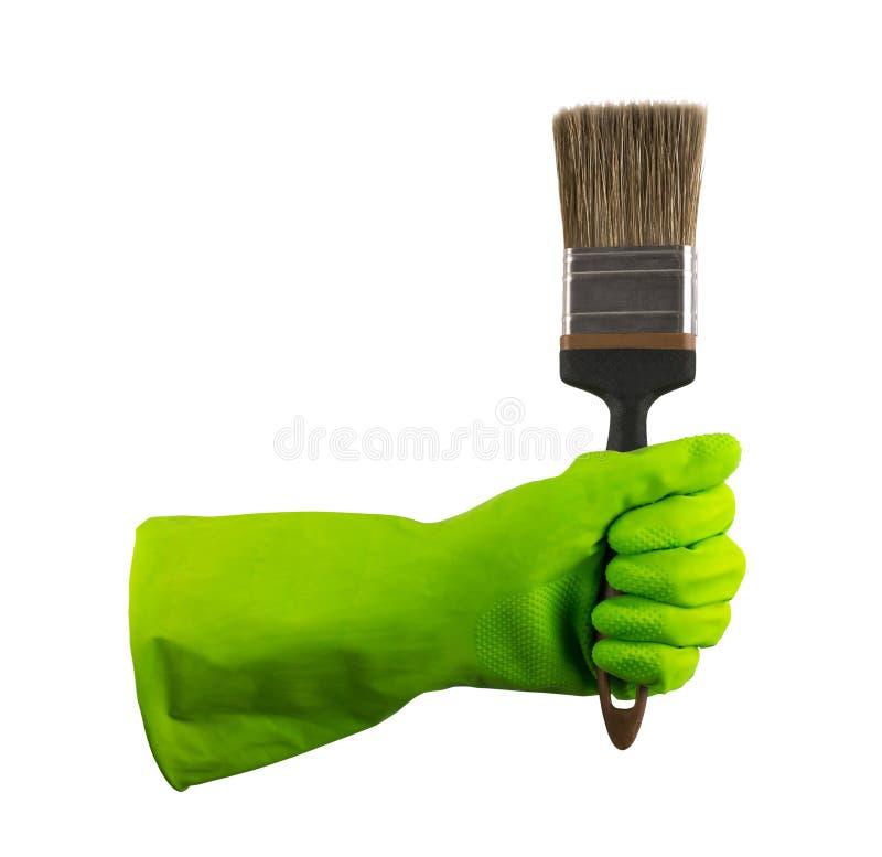 Mano en el guante de goma protector verde aislado fotos de archivo