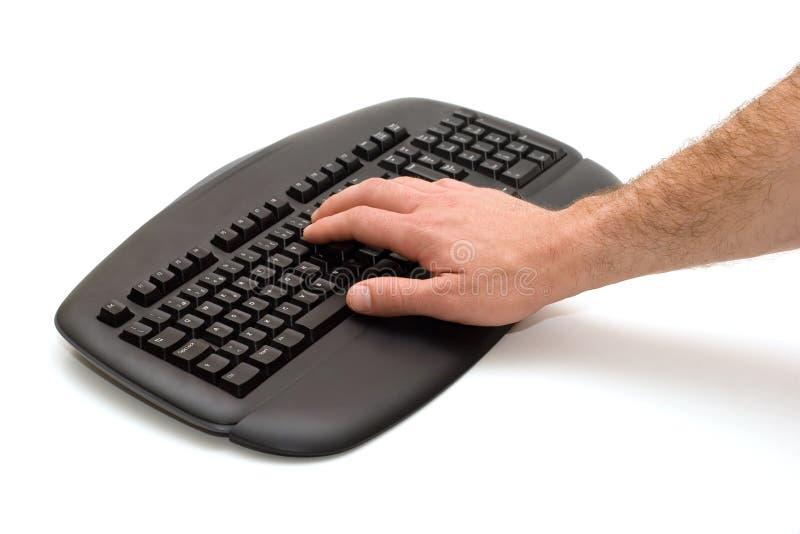 Mano en el teclado imagenes de archivo