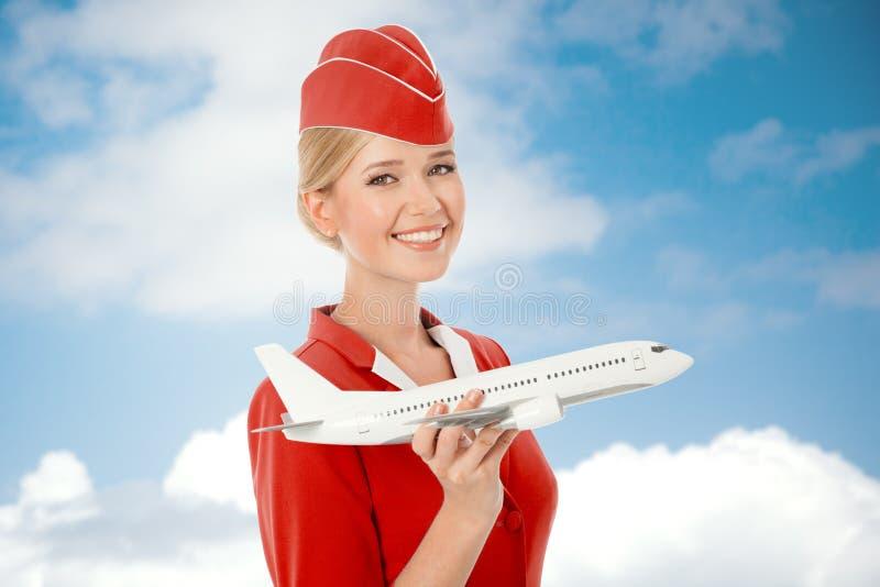 Mano encantadora de Holding Airplane In de la azafata foto de archivo libre de regalías