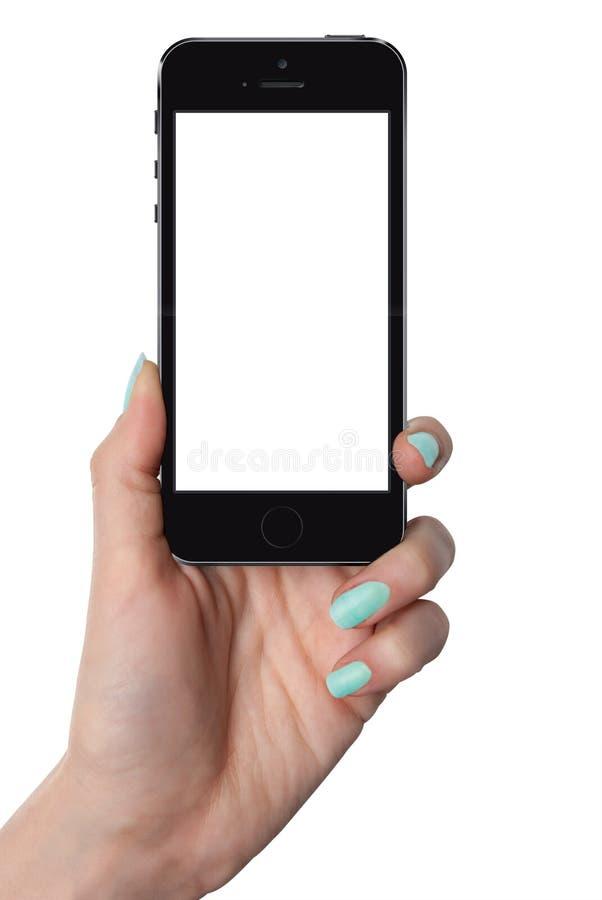 Mano femenina aislada que sostiene el teléfono elegante imagen de archivo