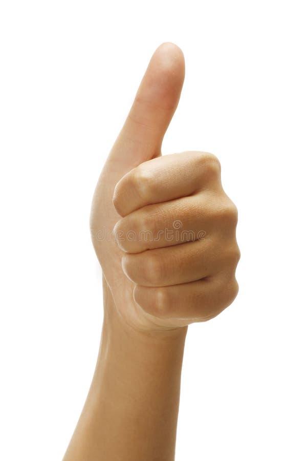 Mano femenina con los pulgares encima del gesto positivo foto de archivo