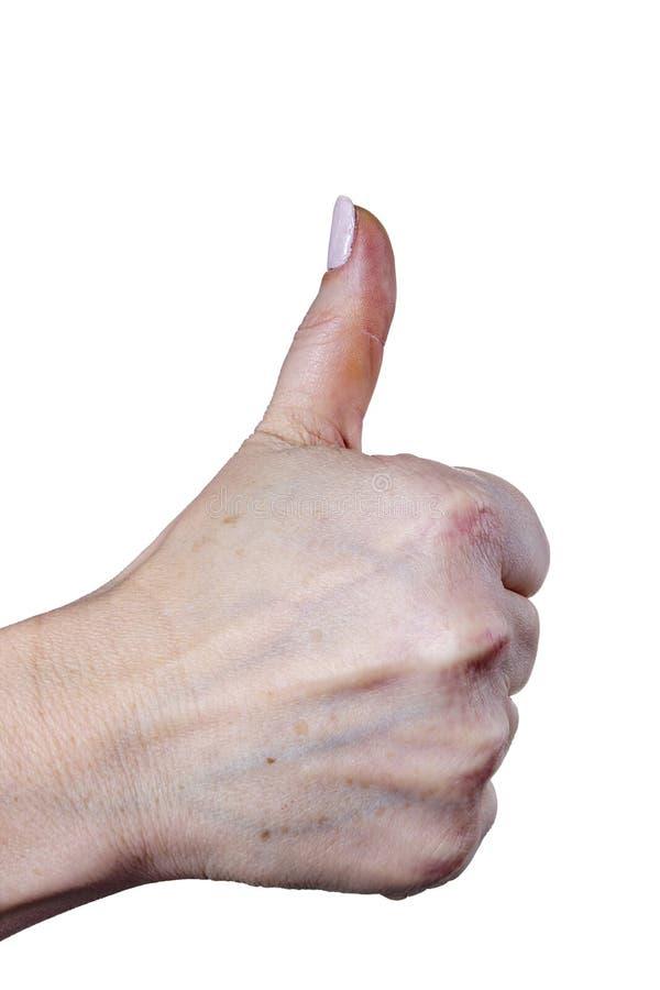 Mano femenina con los pulgares encima del gesto positivo imágenes de archivo libres de regalías