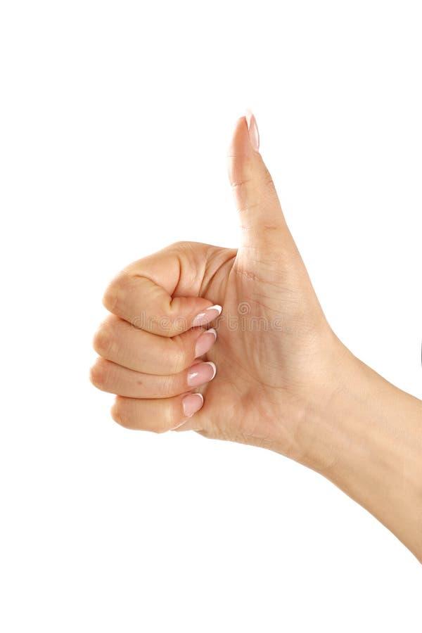 Mano femenina hermosa que hace el pulgar encima del gesto foto de archivo libre de regalías