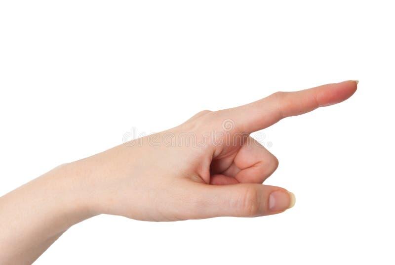 Mano femenina que señala con el dedo índice aislado en blanco fotos de archivo