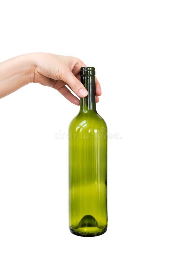 Mano femenina que sostiene la botella de cristal vacía aislada en blanco Basura reciclable Reciclando, la reutilización, disposic fotos de archivo libres de regalías
