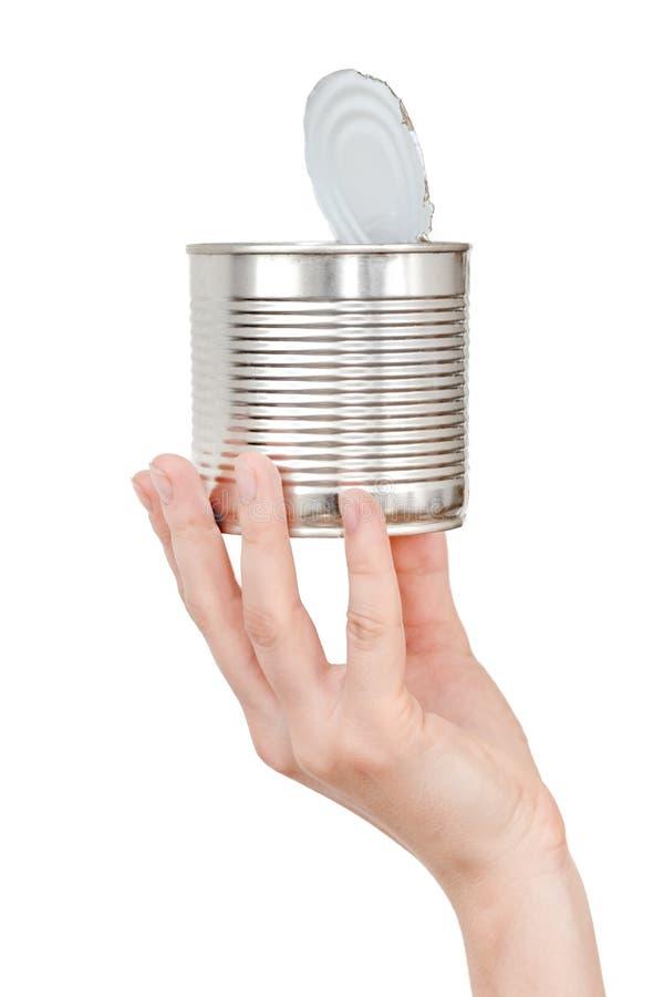 Mano femenina que sostiene la lata vacía Basura reciclable Concep del reciclaje, de la reutilización, de la disposición de basura imagen de archivo libre de regalías