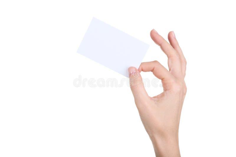 Mano femenina que sostiene la tarjeta en blanco fotos de archivo libres de regalías