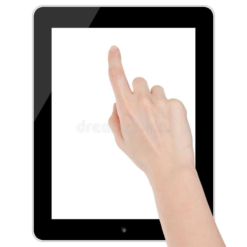 Mano femenina que toca un espacio en blanco de la tableta aislado imagen de archivo