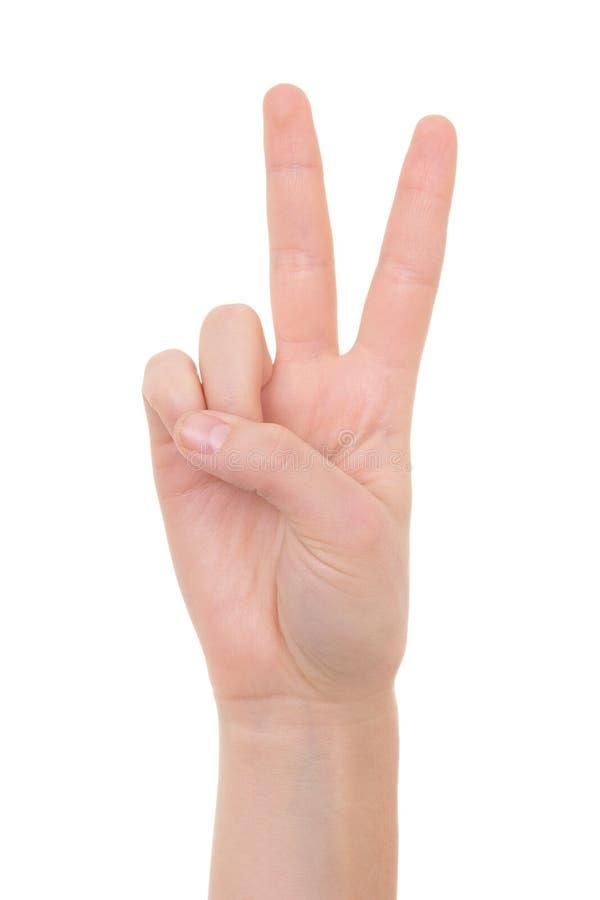 Mano femminile che mostra il segno di pace isolato su bianco fotografia stock