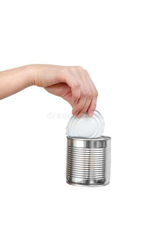 Mano femminile che tiene il barattolo di latta vuoto Spreco riciclabile Concep di riciclaggio, di riutilizzazione, di tritarifiut fotografia stock