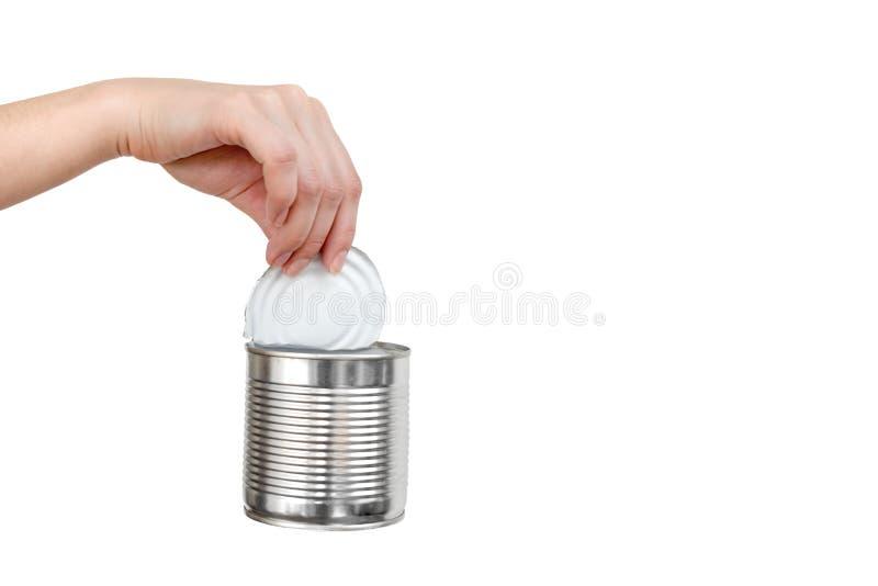 Mano femminile che tiene il barattolo di latta vuoto Spreco riciclabile Concep di riciclaggio, di riutilizzazione, di tritarifiut immagine stock