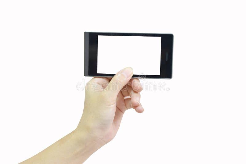 Mano femminile che tiene Smart Phone moderno con lo schermo bianco su briciolo fotografia stock