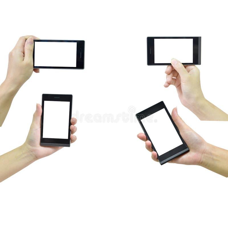Mano femminile che tiene Smart Phone moderno con lo schermo bianco su briciolo immagine stock