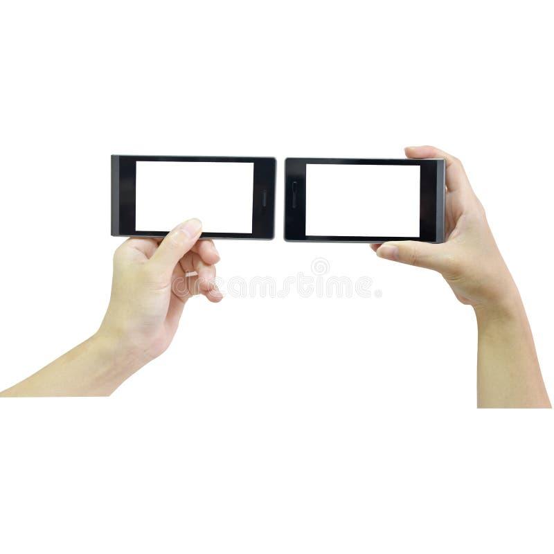 Mano femminile che tiene Smart Phone moderno con lo schermo bianco su briciolo immagini stock