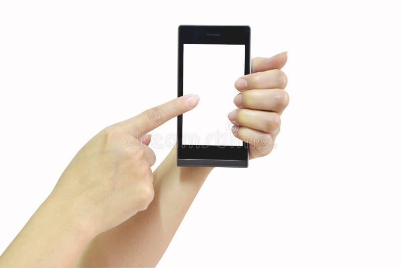 Mano femminile che tiene Smart Phone moderno con lo schermo bianco su briciolo fotografia stock libera da diritti