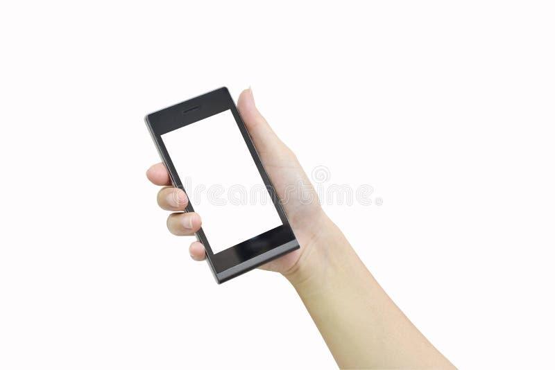 Mano femminile che tiene Smart Phone moderno con lo schermo bianco su briciolo immagini stock libere da diritti