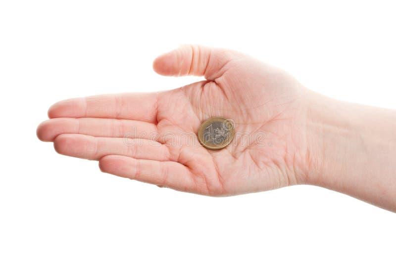 Mano femminile che tiene un'euro moneta fotografie stock libere da diritti
