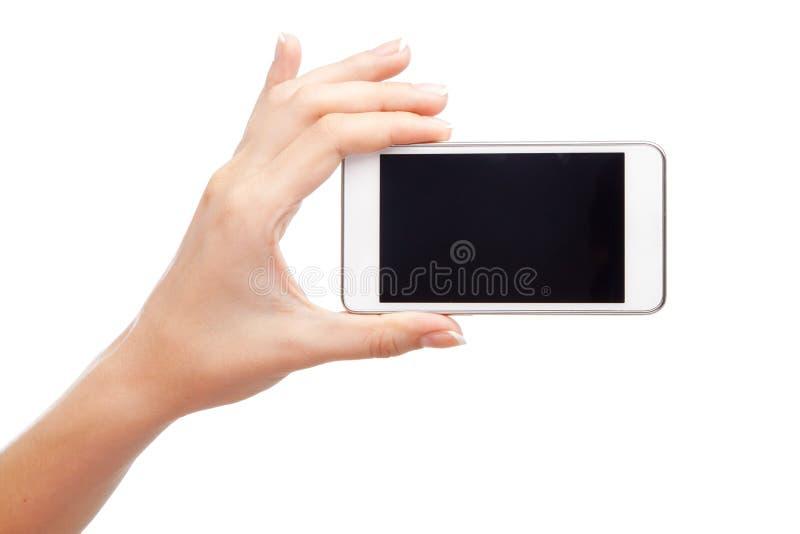 Mano femminile che tiene uno smartphone moderno fotografia stock