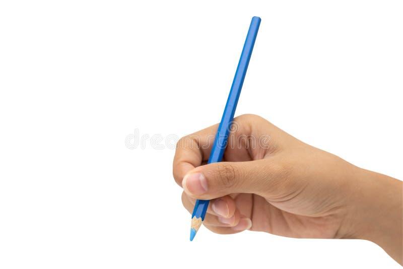 Mano femminile con la matita blu di colore isolata su bianco fotografie stock