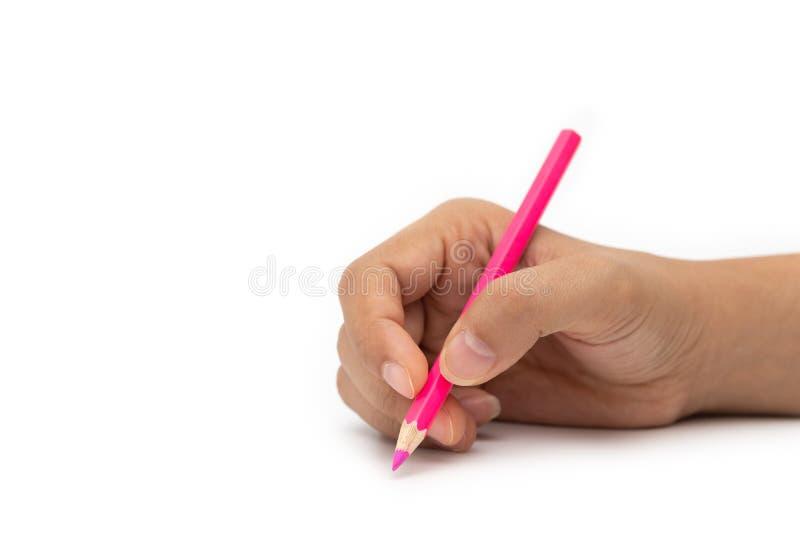 Mano femminile con la matita variopinta isolata su fondo bianco fotografia stock