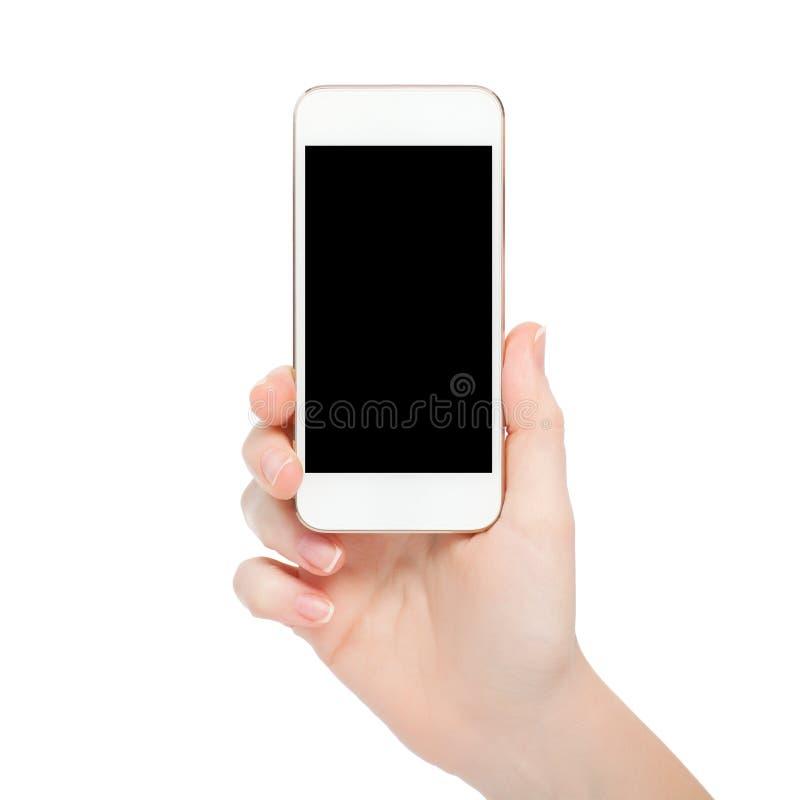 Mano femminile isolata che tiene il telefono bianco di tocco immagini stock libere da diritti