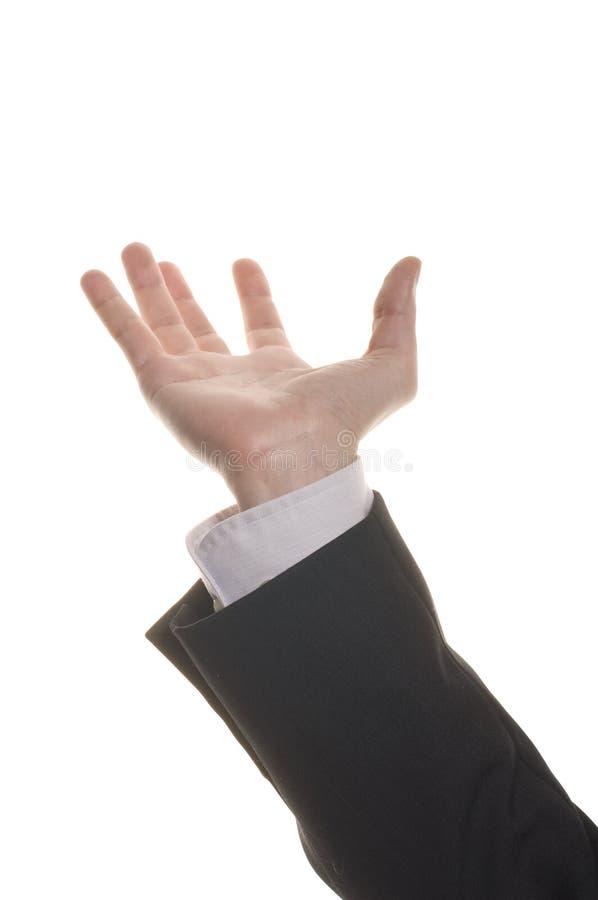 Mano formada receptor de papel del hombre de negocios que alcanza para algo imagenes de archivo