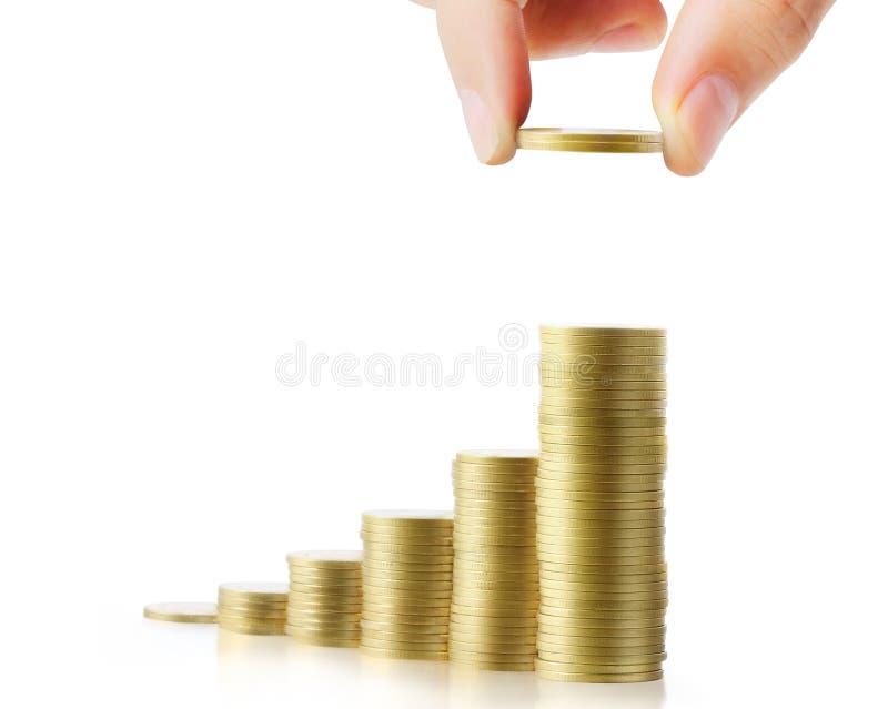 Mano humana de la mano humana que pone la moneda al dinero fotos de archivo