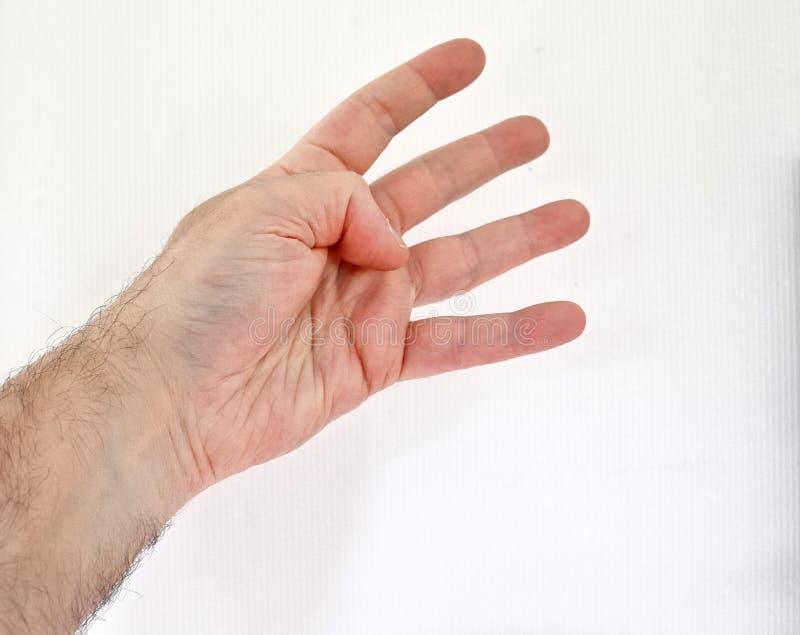 Mano humana masculina que muestra diversos gestos y símbolos fotos de archivo
