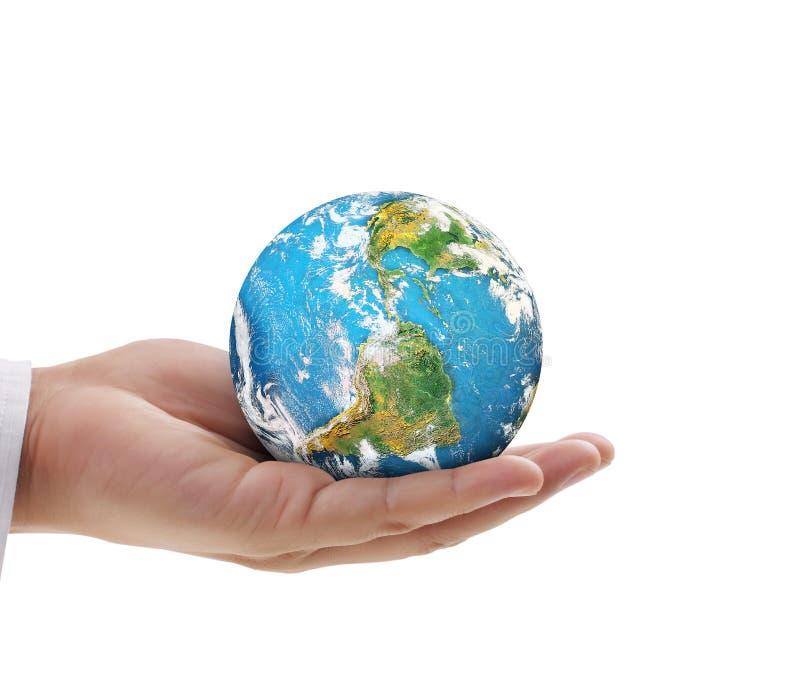 Mano humana que lleva a cabo elementos del globo de la imagen suministrados por la NASA imagenes de archivo
