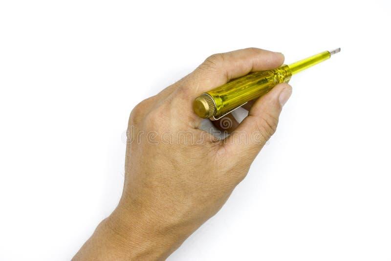 Mano maschio che tiene il cacciavite elettrico del tester per controllare l'elettrico, luce della prova, mano dell'uomo isolata s fotografia stock