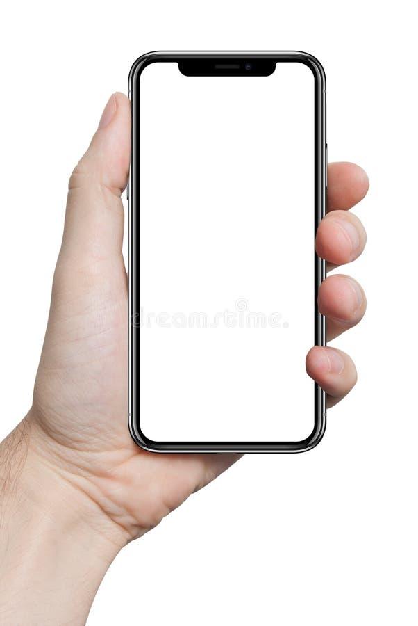 Mano masculina aislada que lleva a cabo el gadge del ordenador del tacto de la tableta del teléfono fotos de archivo