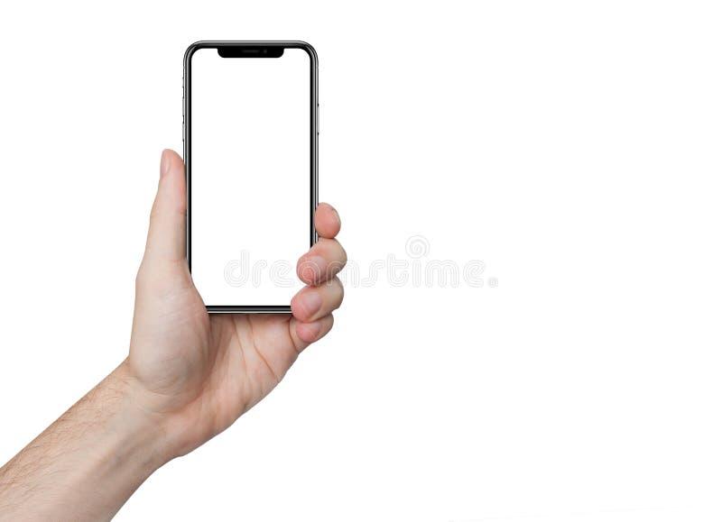 Mano masculina aislada que sostiene el teléfono aislado imagenes de archivo