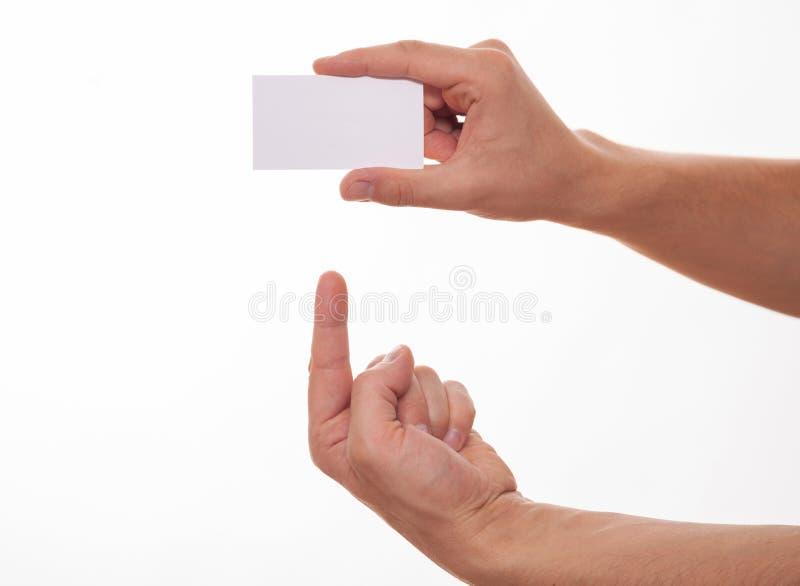 Mano masculina que indica una tarjeta de visita vacía foto de archivo