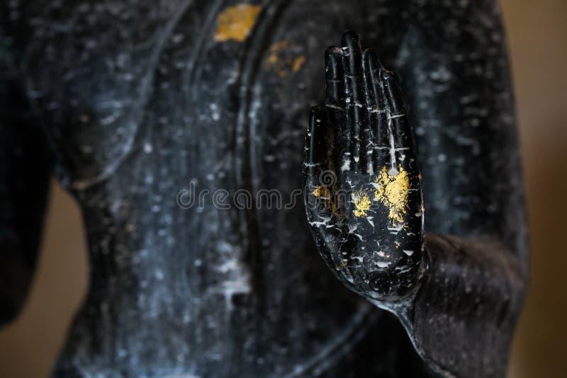 Mano negra de Buda foto de archivo libre de regalías
