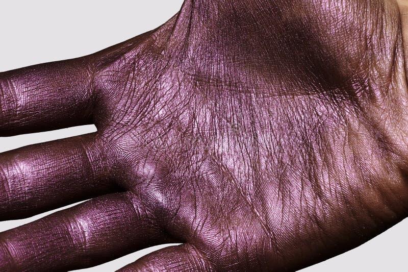 Mano púrpura Textura brillante de la piel para hacer publicidad imagen de archivo libre de regalías
