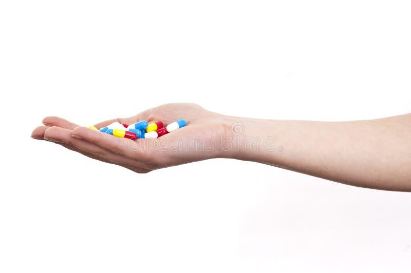 Mano in pieno delle pillole fotografia stock libera da diritti