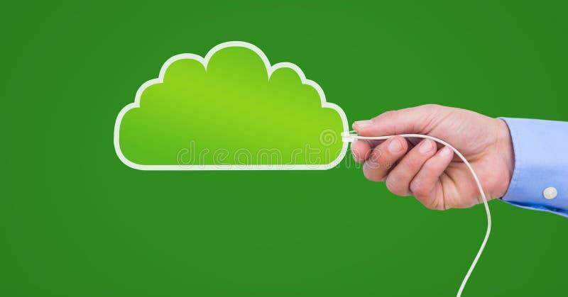 Mano que celebra la conexión del alambre con la nube fotos de archivo