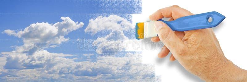 Mano que dibuja un cielo con un cepillo coloreado - imagen del concepto con el espacio de la copia stock de ilustración