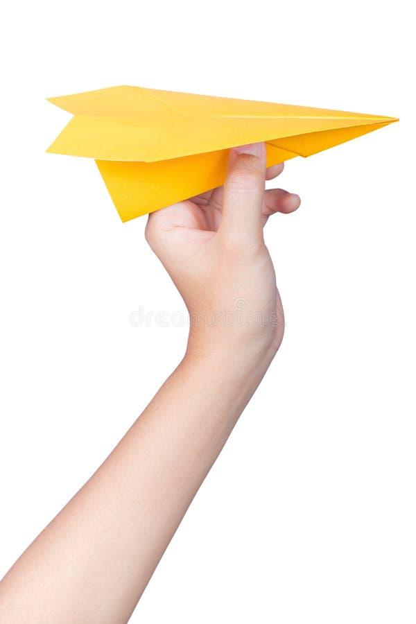 Mano que lleva a cabo el avión de papel imagen de archivo