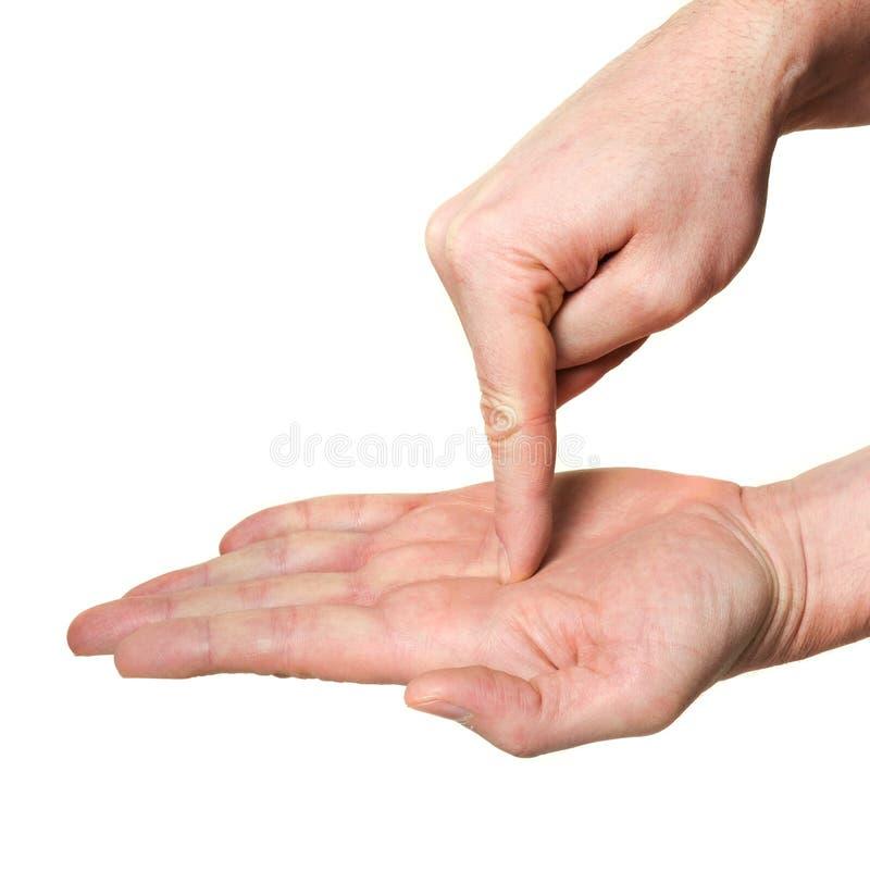 Mano que señala el dedo dentro de la palma fotos de archivo libres de regalías
