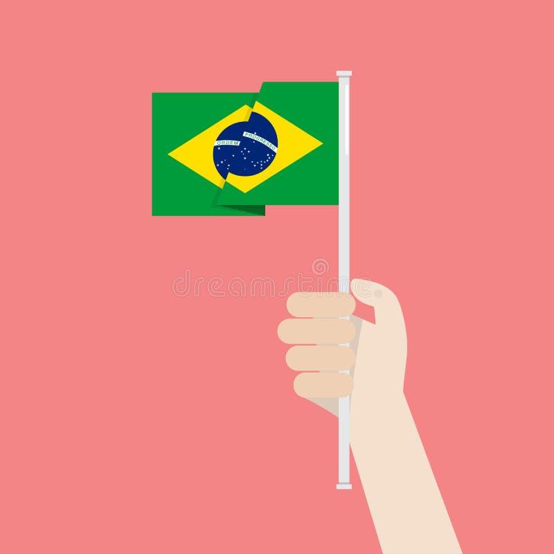 Mano que soporta la bandera del Brasil libre illustration