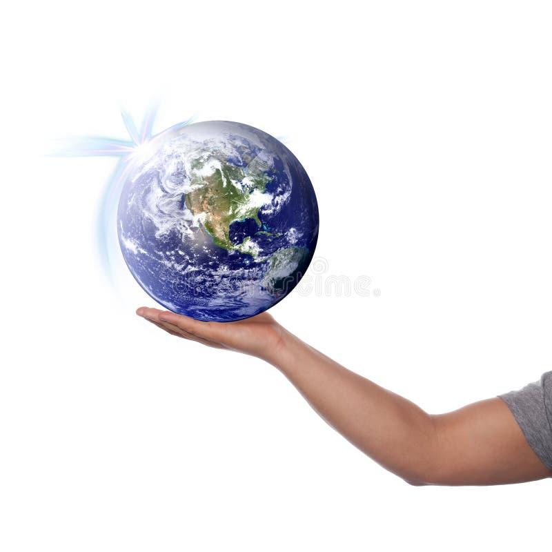 El mundo en su mano fotografía de archivo libre de regalías